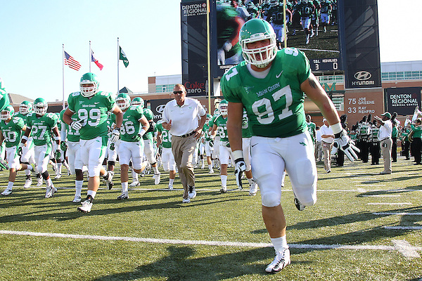 Denton, TX - NOVEMBER 3:Richard Abbe #97 of the North Texas Mean Green runs on to the field before the start of the game against the Arkansas State Red Wolves at Apogee Stadium in Denton on November 3, 2012 in Denton, Texas. Photo by: Rick Yeatts