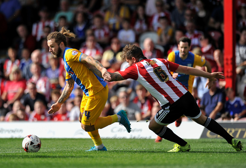 Preston North End's Stevie May holds off the challenge from Brentford's Harlee Dean<br /> <br /> Photographer Ashley Western/CameraSport<br /> <br /> Football - The Football League Sky Bet Championship - Brentford v Preston North End - Saturday 19th September 2015 - Griffin Park - London<br /> <br /> &copy; CameraSport - 43 Linden Ave. Countesthorpe. Leicester. England. LE8 5PG - Tel: +44 (0) 116 277 4147 - admin@camerasport.com - www.camerasport.com