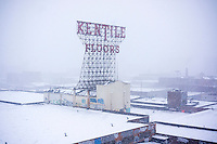 "The landmark Kentile Floors sign in the Gowanus neighborhood of Brooklyn in New York is seen during a white out in a snow storm on Tuesday, January 21, 2014. The city is expected to receive between 8 and 14 inches of snow with brutal ""Polar Express"" temperatures in the single digits. The snow will taper off by Wednesday morning but the arctic temperatures are expected to last several days.  (© Richard B. Levine)"