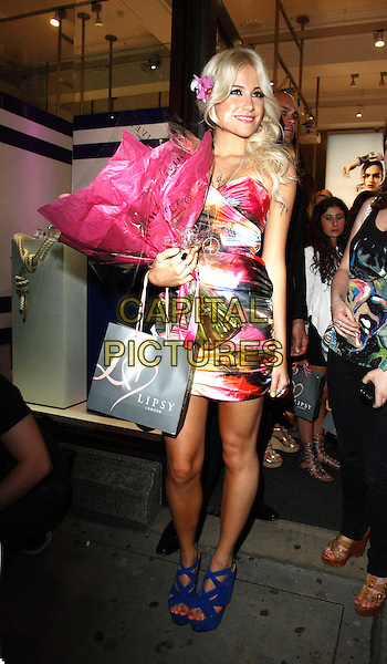 PIXIE LOTT ( VICTORIA LOUISE LOTT).At the Pixie Lott for Lipsy Party, Swarovski Crystallized Boutique, London, England, UK, April 21st 2011..full length flowers bouquet dress blue sandals wedges white pink print strapless dress .CAP/ROS .©Steve Ross/Capital Pictures