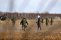 Pictured: Greek riot police and army officers by the border. Sunday 01 March 2020<br /> Re: Clashes between migrants and riot police at the Greek-Turkish border of Kastanies near Evros, Greece