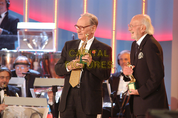 MORRICONE TROVAGLIOLI.David di Donatello Italian Awards at the Gran Teatro di Tor di Quinto, Rome, Italy, 14th June 2007..half length on stage show award winner.CAP/CAV.©Luca Cavallari/Capital Pictures.