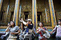 Tourists visit the Grand Palace Complex in Bangkok, Thailand