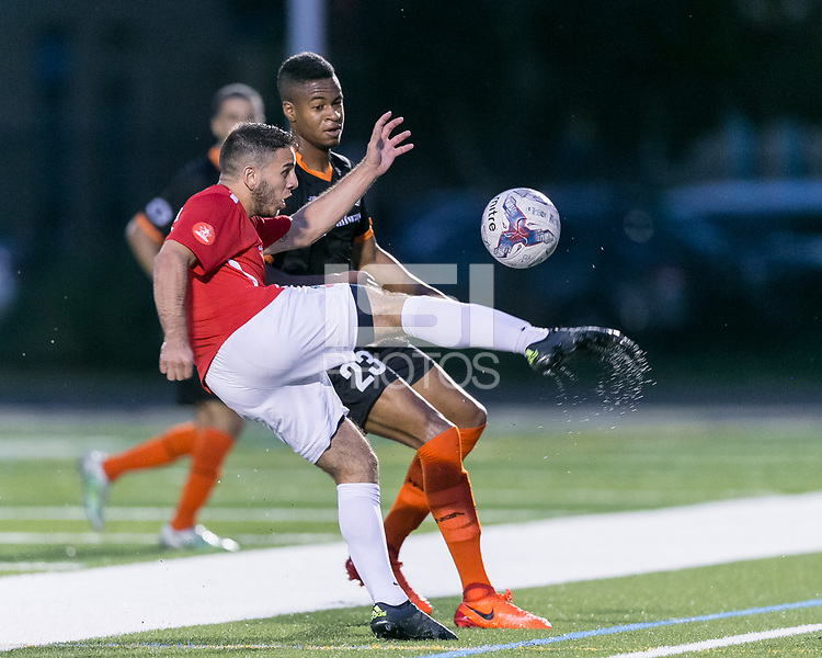 Malden, Massachusetts - July 8, 2017: In a  National Premier Soccer League (NPSL) match, Boston City FC (white/red) defeated Kingston Stockade (black), 2-0, at Brother Gilbert Stadium on Donovan Field.