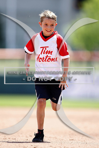 May 23, 2009:  A young fan heads towards third base in the base race with Buster during a game at Coca-Cola Field in Buffalo, NY.  Photo by:  Mike Janes/Four Seam Images