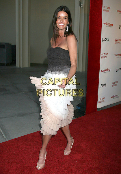 "JANICE DICKINSON .""Valentino: The Last Emperor"" Los Angeles Premiere held at LACMA,  Los Angeles, CA, USA, .1st April 2009..full length strapless black white ruffle dress tiered beige layered patent shoes open toe peep .CAP/ADM/MJ.©Michael Jade/Admedia/Capital Pictures"