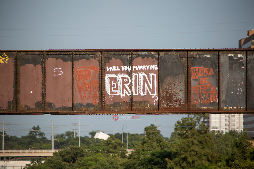 "Not only does the Austin Railroad Graffiti Bridge over Lady Bird Town Lake contain some of Austin's most famous and cherished graffiti mural paintings, but marriage proposals too as in the ""Will You Marry Me Erin?"" proposal."