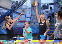 NWA Democrat-Gazette/ANDY SHUPE<br /> McKenzie Gulledge, 11, (from left); Annie Beth Mabry, 11; Caroline Lyles, 11; and Shelly Howard; all of Fayetteville, celebrate Thursday, Sept. 3, 2015, after Caroline threw a ping pong ball into a fish bowl to win a goldfish during the Washington County Fair at the county fairgrounds in Fayetteville.