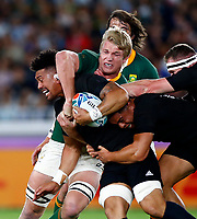 Pieter-Steph du Toit tackling Ardie Savea of New Zealand (All Blacks) during the Rugby World Cup Pool B match between the New Zealand All Blacks and South Africa Springboks at the International Stadium in Yokohama, Japan on Saturday, 21 September, 2019. Photo: Steve Haag / stevehaagsports.com