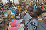A mother and child in a camp for over 5,000 internally displaced persons in an Episcopal Church compound in Wau, South Sudan. Most of the families here were displaced by violence early in 2017, after a larger number took refuge in other church sites when widespread armed conflict engulfed Wau in June 2016.<br /> <br /> Norwegian Church Aid, a member of the ACT Alliance, has provided relief supplies to the displaced in Wau, and has supported the South Sudan Council of Churches as it has struggled to mediate the conflict in Wau.