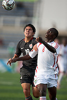 Victor Chavez battles against Peter Mselema. US Men's National Team Under 17 defeated Malawi 1-0 in the second game of the FIFA 2009 Under-17 World Cup at Sani Abacha Stadium in Kano, Nigeria on October 29, 2009.