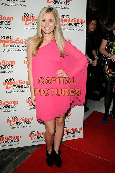 CARLEY STENSON .Attending the Inside Soap Awards 2010 held at Shaka Zulu, Camden, London, England, UK, September 27th 2010. arrivals full length black ankle boots pink one sleeve shoulder dress hand on hip .CAP/CAN.©Can Nguyen/Capital Pictures.