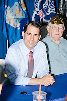 Republican presidential candidate and governor of Wisconsin Scott Walker speaks at a meet and greet with veterans at the Derry VFW in Derry, New Hampshire.