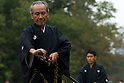 November 3, 2011, Tokyo, Japan - A swordsman sheaths his katana at the completion of his kata at a martial arts demonstration for Japan's National Culture Day at Meiji shrine in Tokyo. (Photo by Bruce Meyer-Kenny/AFLO) [3692]
