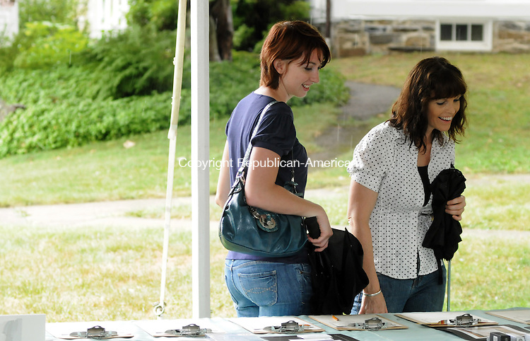 WASHINGTON, CT 10 JULY, 2010-0710JS12-FOR COUNTRY LIFE-Jade Summers, left, and her sister Sapphire Summers, both of Plymouth, Mass. look over silent auction items during the Washington Fair at the First Congregational Church on the Green in Washington.<br /> Jim Shannon Republican-American