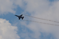 F-16 aircraft of the Belgian Airforce performs during the International Air Show at the Hungarian Air Force base in Kecskemet (about 87 km South-East of the capital city Budapest), Hungary on August 03, 2013. ATTILA VOLGYI