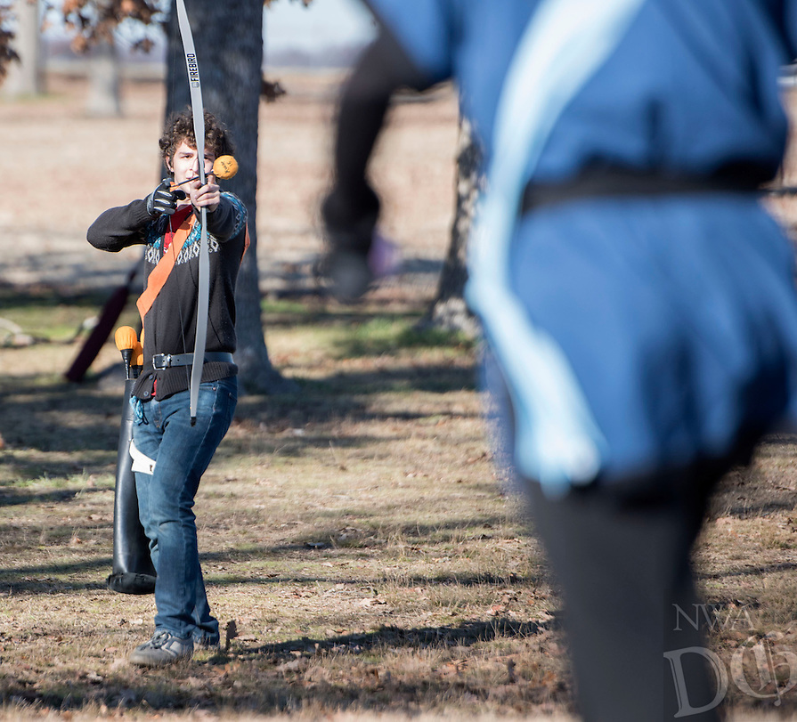 NWA Democrat-Gazette/J.T. WAMPLER Derick brown, known as Okami, takes aim with his bow and padded arrow while playing a game called Reliquary Sunday Jan. 3, 2016 while participating in a live action role playing game, or LARP, at Agri Park in Fayetteville. Around 15 members of the Shire of Razor Hills meet every Sunday at the park to engage in the live action combat game and use padded weapons to bludgeon each other during a variety of strategy scenarios. http://nwamedia.photoshelter.com/