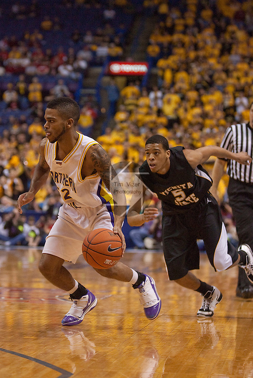 March 7,  2010           Northern Iowa guard Anthony James (52) dribbles as Wichita State guard Demetric Williams (5) comes on him fast from behind in the second half.  The University of Northern Iowa defeated Wichita State 67-52 on Sunday March 7, 2010 in the championship game of the Missouri Valley Conference Tournament at the Scottrade Center in downtown St. Louis.   They automatically earn a berth in the NCAA Tournament.