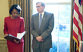 Washington, DC - October 29, 2008 -- United States Secretary of State Condoleezza Rice (L) and National Security Advisor Stephen Hadley stand together in the Oval Office during a meeting between US President George W. Bush and Kurdish President Massoud Barzani at the White House in Washington, DC, USA on 29 October 2008. The two leaders discussed issues of mutual concern. <br /> Credit: Matthew Cavanaugh - Pool via CNP