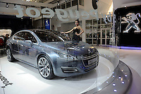A model poses by a 5 by Peugeot concept car at the Beijing Auto Show. The car show has attracted all the world's major auto markers. China's vehicle sales have breached the 10-million barrier for the first time ever, with 10.9 million automobiles sold last year. .24 Apr 2010