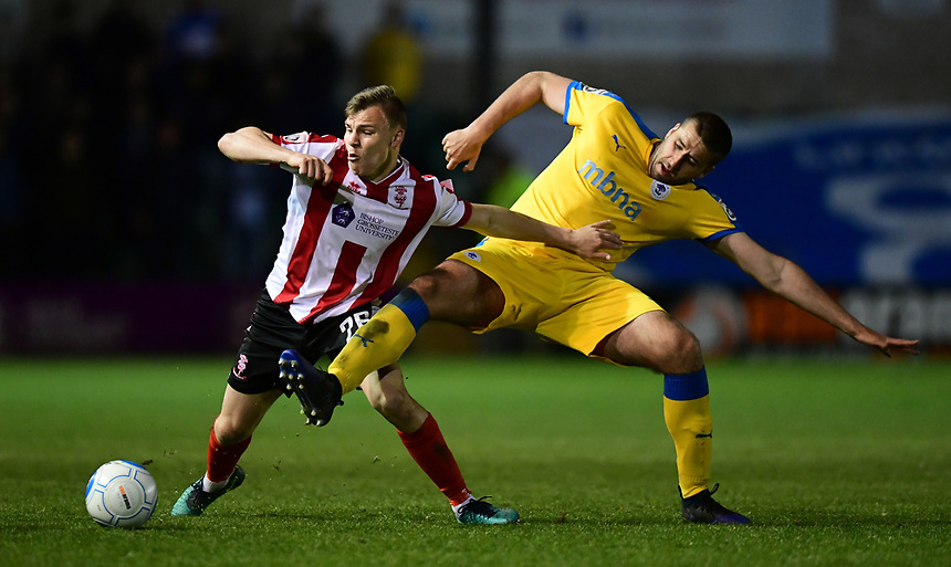 Lincoln City's Harry Anderson vies for possession with Chester's Ryan Astles<br /> <br /> Photographer Chris Vaughan/CameraSport<br /> <br /> Vanarama National League - Lincoln City v Chester - Tuesday 11th April 2017 - Sincil Bank - Lincoln<br /> <br /> World Copyright &copy; 2017 CameraSport. All rights reserved. 43 Linden Ave. Countesthorpe. Leicester. England. LE8 5PG - Tel: +44 (0) 116 277 4147 - admin@camerasport.com - www.camerasport.com