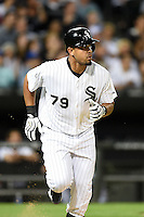 Chicago White Sox first baseman Jose Abreu (79) running to first during a game against the Toronto Blue Jays on August 15, 2014 at U.S. Cellular Field in Chicago, Illinois.  Chicago defeated Toronto 11-5.  (Mike Janes/Four Seam Images)