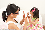 """18 month old toddler girl with mother language development """"High fives"""" or clapping hands"""