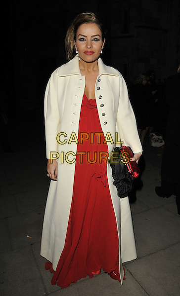 Elen Rivas.attending the Square Mile Masked Ball, Royal Courts of Justice, the Strand, London, England, UK, .25th November 2011..full length red long maxi dress white coat  clutch bag .CAP/CAN.©Can Nguyen/Capital Pictures.