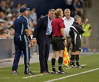 Peter Vermes, Corey Rockwell, Sigi Schmid, Michael Kennedy, referees. Sporting Kansas City won the Lamar Hunt U.S. Open Cup on penalty kicks after tying the Seattle Sounders in overtime at Livestrong Sporting Park in Kansas City, Kansas.