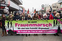 """Ca. 800 Menschen folgten am Samstag den 17. Februar 2018 in Berlin dem Aufruf der AfD-Frau Leyla Bilge zu einem sog. """"Marsch der Frauen"""". Sie demonstrierten gegen Zuwanderung und Fluechtlinge, die """"nur nach Deutschland kommen um hier Frauen zu schaenden"""" so einige Teilnehmer.<br /> Der rechte Aufmarsch wurde nach 750 Metern durch Strassenblockaden von ca. 2.000 Menschen gestoppt. Leyla Bilge weigerte sich als Anmelderin drei Stunden lang den blockierten  Aufmarsch zu beenden und forderte von der Polizei die Blockaden zu raeumen. Ein Raeumungsversuch der Polizei scheiterte, da es zu viele Menschen waren, die auf der Strasse sassen.<br /> Nach drei Stunden beendete Bilge den Aufmarsch. Die Demosntranten, unter ihnen etliche Neonazis, sog. """"Identitaere"""" und AfD-Politiker zogen darauf ab und griffen dabei Gegendemosntranten und Polizeibeamte an. Mehrere Personen wurden festgenommen. Ein Teil fuhr zum Kanzleramt, dem urspruenglichen Ziel des Aufmarsches.<br /> Rechts im Bild: Heidi Mund, christlich-fundamentalistische Intiislamistin aus Frankfurt am Main. 2015 wurde sie wegen Volksverhetzung angezeigt, die Staatsanwaltschaft Frankfurt ermittelte gegen sie.<br /> 17.2.2018, Berlin<br /> Copyright: Christian-Ditsch.de<br /> [Inhaltsveraendernde Manipulation des Fotos nur nach ausdruecklicher Genehmigung des Fotografen. Vereinbarungen ueber Abtretung von Persoenlichkeitsrechten/Model Release der abgebildeten Person/Personen liegen nicht vor. NO MODEL RELEASE! Nur fuer Redaktionelle Zwecke. Don't publish without copyright Christian-Ditsch.de, Veroeffentlichung nur mit Fotografennennung, sowie gegen Honorar, MwSt. und Beleg. Konto: I N G - D i B a, IBAN DE58500105175400192269, BIC INGDDEFFXXX, Kontakt: post@christian-ditsch.de<br /> Bei der Bearbeitung der Dateiinformationen darf die Urheberkennzeichnung in den EXIF- und  IPTC-Daten nicht entfernt werden, diese sind in digitalen Medien nach §95c UrhG rechtlich geschuetzt. Der Urhebervermerk wird gemaess §13 UrhG verlangt.]"""