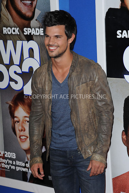 WWW.ACEPIXS.COM<br /> July 10, 2013...New York City <br /> <br /> Taylor Lautner attending the Columbia Pictures New York Screening of &quot;Grown Ups 2&quot;  at AMC Loews Lincoln Square on July 10, 2013 in New York City.<br /> <br /> Please byline: Kristin Callahan... ACE<br /> Ace Pictures, Inc: ..tel: (212) 243 8787 or (646) 769 0430..e-mail: info@acepixs.com..web: http://www.acepixs.com