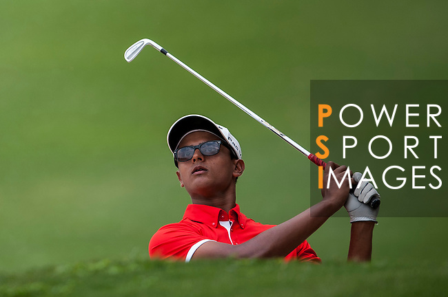 Viraaj Ganapathy Madappa of India in action at the 9th Faldo Series Asia Grand Final 2014 golf tournament on March 18, 2015 at Faldo course in Mid Valley clubhouse in Shenzhen, China. Photo by Xaume Olleros / Power Sport Images