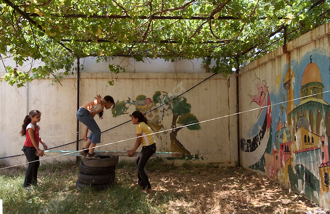 Palestinian girls from the Naher al Bared refugee camp playing at the Beit Atfal Assomoud Center in Baddawi refugee camp, Tripoli, Lebanon, 28 May 2007.
