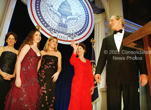 United States President George W. Bush and First Lady Laura Bush and their twin daughters Barbara (maroon dress) and Jenna (black dress) attend one of nine inaugural balls in Washington, D.C. on January 20, 2001..Credit: Robert Trippett / Pool via CNP.