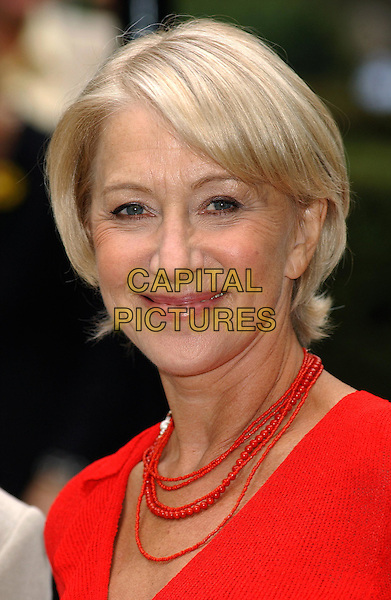 HELEN MIRREN .Calendar Girls Press Conference. The Savoy Hotel, London.2nd September 2003 .headshot, portrait, red beads, necklace.www.capitalpictures.com.sales@capitalpictures.com.Supplied By Capital Pictures
