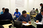Students at Montgomery College begin work on their group final project in their Basic Writing II class at the Takoma Campus on Dec. 11, 2012. If students pass this class, it allows them to progress to the college level english program. Otherwise students will face the decision to take the remedial class again or drop out.