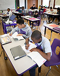WATERBURY,  CT-031419JS04- Sixth grade students at Brass City Charter School in Waterbury, work inside their classroom at the school on Wednesday. School districts around the city and region are showing improvements on the state's annual report card on school and district accountability. <br /> Jim Shannon Republican American