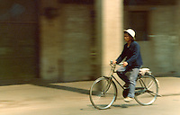 Man on his bicycle, pictures taken in Canton China in 1977 at the time of the cultural revolution.