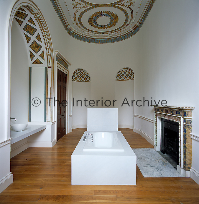 This bathroom was remodelled by Sir John Soane in the 1790s to which John Pawson has added a contemporary marble bath