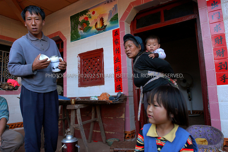 12/3/2004--Ban Lao Village, Yongde County, Yunnan, China..Mo Shuli, 39, (right) from Ban Lao village in Yongde County, who had a relative arrested earlier this year for drug smuggling and now faces the death penalty. The county is one of the worst counties in China for drug smuggling, with heroin coming across the border from nearby Burma...Photograph by Stuart Isett.©2004 Stuart Isett. All rights reserved