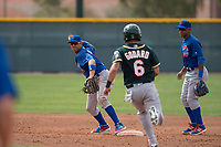 Chicago Cubs shortstop Aramis Ademan (11) and second baseman Yeiler Peguero (15) attempt to turn a double play in front of Javier Godard (6) during a Minor League Spring Training game against the Oakland Athletics at Sloan Park on March 13, 2018 in Mesa, Arizona. (Zachary Lucy/Four Seam Images)
