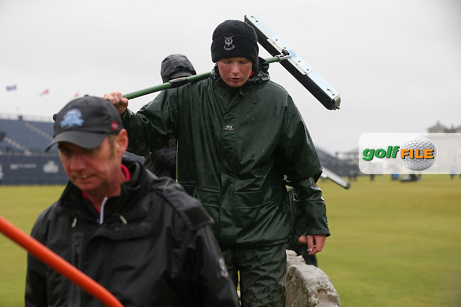 Over the Swilcan Bridge they come, heroes of the hour. St Andrews ground staff clear the surface flooding during the postponement of play of Round Two of the 144th Open, played at the Old Course, St Andrews, Scotland. /17/07/2015/. Picture: Golffile | David Lloyd<br /> <br /> All photos usage must carry mandatory copyright credit (&copy; Golffile | David Lloyd)