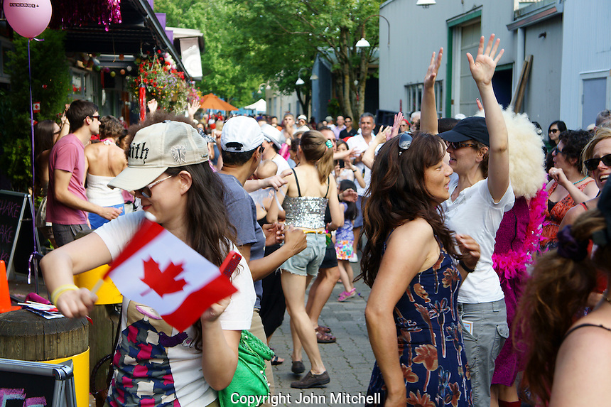 VANCOUVER, CANADA, 1st July 2013. People dancing outdoors at Canada Day celebrations on Granville Island in Vancouver, BC. Canada Day or Fete du Canada is an annual national holiday celebrating Canada's birth as a nation  in 1867.