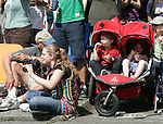 FIve -year-old Harper Holman and his three-year-old sister, Rainier, eat ice cream while watching the Painted nude bicyclists  ride during the 25th  Annual Fremont Summer Solstice Parade in Seattle on June 22, 2013. .     UPI Photo/Jim BryantPainted nude bicyclists  ride during the 25th  Annual Fremont Summer Solstice Parade in Seattle on June 22, 2013.     ©2013.  Jim Bryant.  ALL RIGHTS RESERVED.