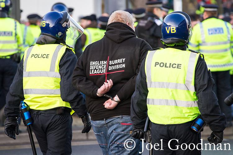 © Joel Goodman - 07973 332324 . 11/12/2010 . Peterborough , UK . Police detain a man at the demonstration . The English Defence League ( EDL ) hold a demonstration in Peterborough . Photo credit : Joel Goodman