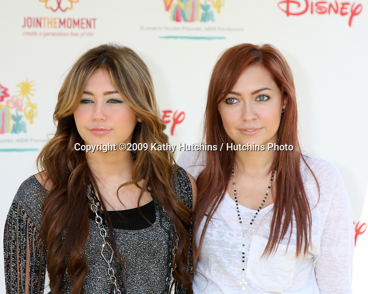 "Miley Cyrus & Sister Brandi Cyrus arriving at the ""A Time For Heroes Celebrity Carnival"" benefiting the Elizabeth Glaser Pediatrics AIDS Foundation at the Wadsworth Theater Grounds in Westwood , CA on June 7, 2009 .©2009 Kathy Hutchins / Hutchins Photo.."
