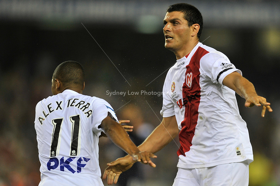 MELBOURNE, AUSTRALIA - JANUARY 22: Alex Terra and John Aloisi of the Heart celebrate Aloisi's goal in round 24 of the  A-League match between the Melbourne Victory and the Melbourne Heart at Etihad Stadium on January 22, 2011 in Melbourne, Australia. (Photo Sydney Low / AsteriskImages.com)