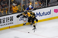 June 12, 2019: Boston Bruins defenseman Brandon Carlo (25) keeps St. Louis Blues center Ryan O'Reilly (90) from the puck during game 7 of the NHL Stanley Cup Finals between the St Louis Blues and the Boston Bruins held at TD Garden, in Boston, Mass.  The Saint Louis Blues defeat the Boston Bruins 4-1 in game 7 to win the 2019 Stanley Cup Championship.  Eric Canha/CSM.