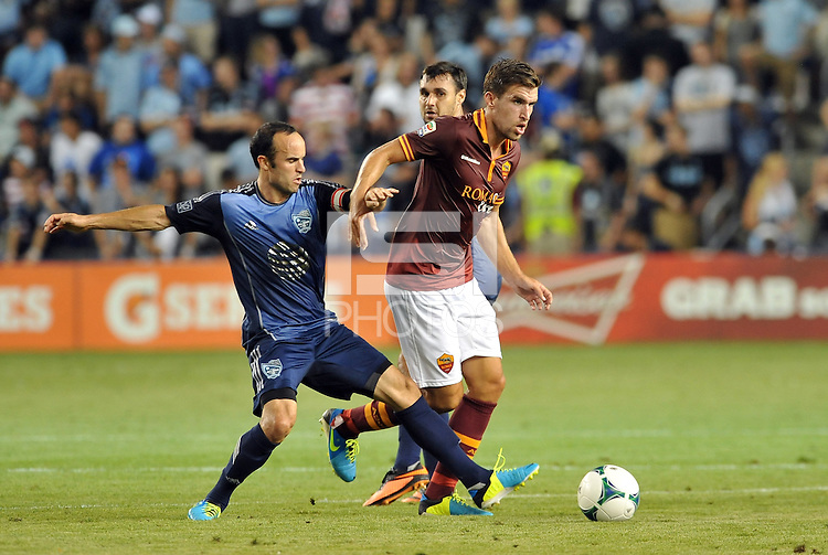 Sporting Park, Kansas City, Kansas, July 31 2013:<br /> Kevin Strootman (6) midfield AS Roma holds off the challenge from Landon Donovan.<br /> MLS All-Stars were defeated 3-1 by AS Roma at Sporting Park, Kansas City, KS in the 2013 AT & T All-Star game.