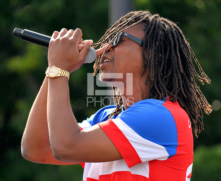Lupe Fiasco performs before the World Cup match between US Men's National team and Ghana. U.S. as fans celebrate and take part in the World Cup festivities and watch the Group G match  between the USMNT vs. Ghana, during the World Cup viewing party hosted by U.S. Soccer at Grant Park in Chicago, IL
